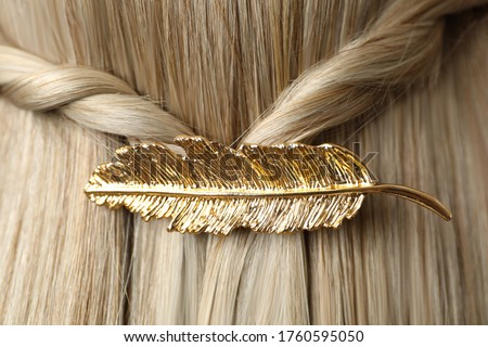 Woman with beautiful gold hair clip, closeup Royalty-Free Stock Photo #1760595050