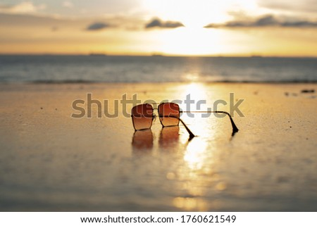 Beach sea sky sunglasses. Find sunglasses beach stock images in HD stock. glasses lie on the sand of a beach against the background of the ocean. landscape glasses background.