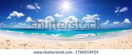 Idyllic Sand Beach With Sun Over Ocean Royalty-Free Stock Photo #1760654924