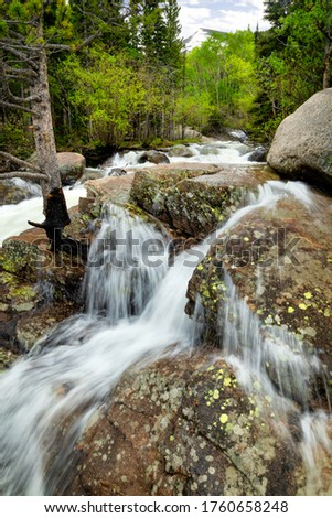 The snow melt causes the rivers and creeks to run over its banks in Rocky Mountain National Park located in Estes Park, Colorado #1760658248