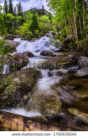 Water rushing down the mountain creek during the spring snow melt #1760658266
