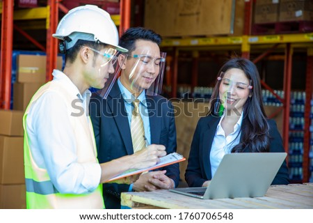 logistic business, shipment and import export delivery Warehouse worker and businessman and women checking goods at warehouse.wholesale, export #1760706548