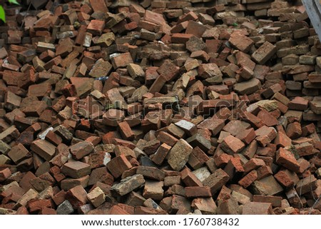 Dump many used bricks. Destroyed or demolished rubble house, background #1760738432