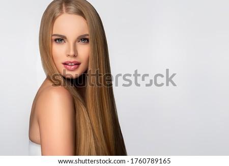 Beautiful model woman with shiny  and straight long hair. Keratin  straightening. Treatment, care and spa procedures. Blonde beauty  girl smooth hairstyle Royalty-Free Stock Photo #1760789165