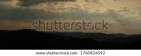Beautiful sunset colors over the mountains of Carpathian, Ukraine, Europe. Sun setting after hot summer day. Photo in orange and blue natural tones #1760826092