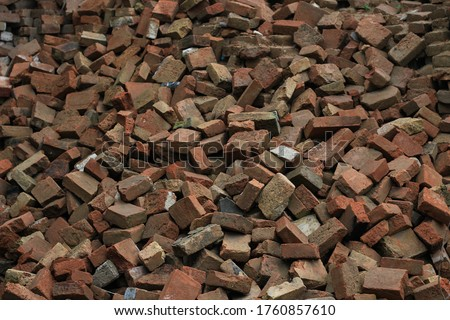 Dump many used bricks. Destroyed or demolished rubble house, background #1760857610