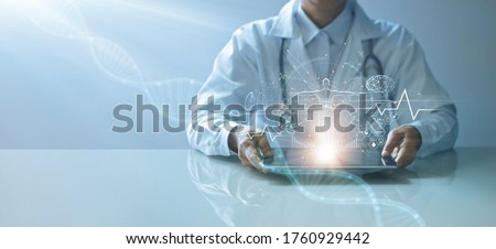 Medicine doctor holding electronic medical record on tablet. DNA. Digital healthcare and network connection on hologram interface, Science and innovative, Medical technology and network concept Royalty-Free Stock Photo #1760929442