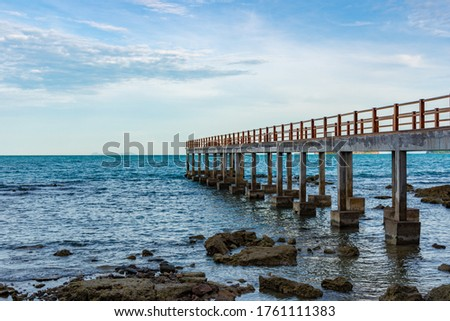 concrete bridge on the island of Koh Samui in Thailand at low tide, pier for mooring ships, building on the south coast of the island #1761111383