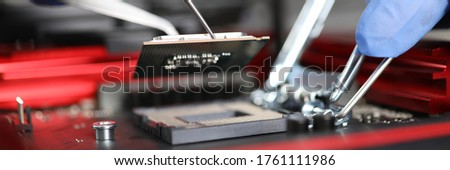 Close-up gloved hands repairing microchip details. Testing microprocessor-based industrial devices. Failure detection diagnostics and device repair. Recovery drive. Microprocessor protection design #1761111986