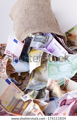 Money bag with euro notes and coins #176111834