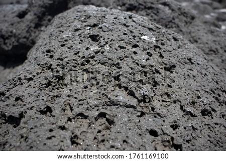 Basalt rock in basalt beach Royalty-Free Stock Photo #1761169100