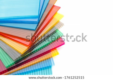Polycarbonate plastic sheets panels images. PC hollow sheet for translucent roofing on white background. Many colors Royalty-Free Stock Photo #1761252515