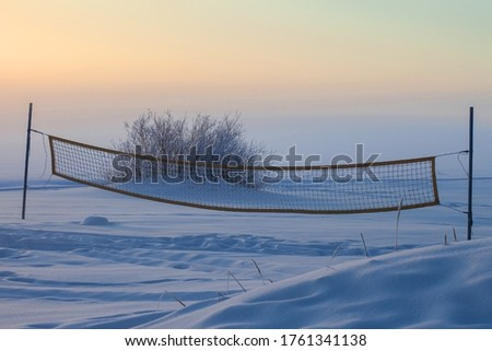 volleyball net, snowy winter landscape, concept, footprints in the snow #1761341138