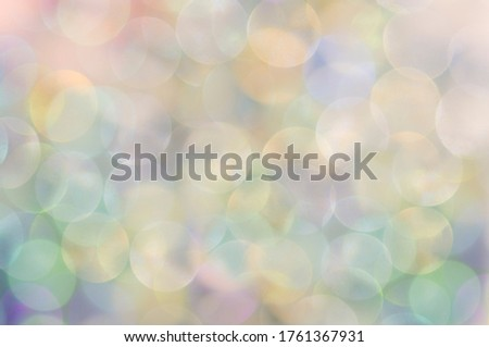 Colorful bubbles, pastel colors. Horizontal photo, bokeh effect, picture for the background, packaging design, holiday theme.