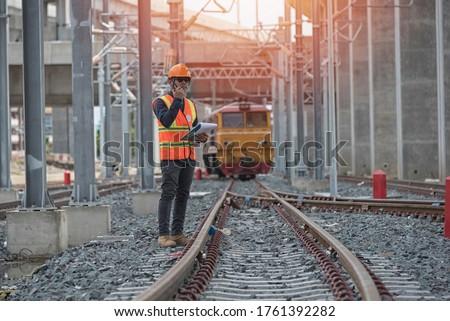 Engineer on railways. engineer train on the railway.Worker walk on railway. engineer railway concept.infrastructure,rails,engineer #1761392282