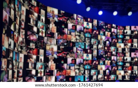 Blurred LED screen of many people faces.Concept : New normal event production.Lots people join online event.Online meeting or seminar. Work at home,video conference,social distancing due to covid-19. #1761427694
