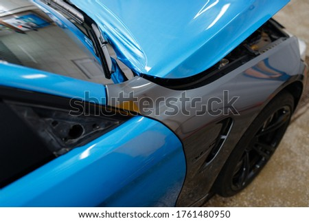 Car wrapping, protective foil or film coating Royalty-Free Stock Photo #1761480950