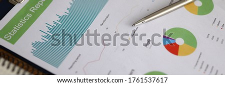 Business chart with silver pen lie on office table closeup background. Buseness education after financial crisis concept #1761537617