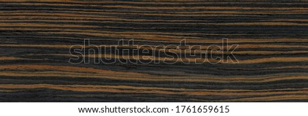 Wood grain texture. Ebony wood, can be used as background.