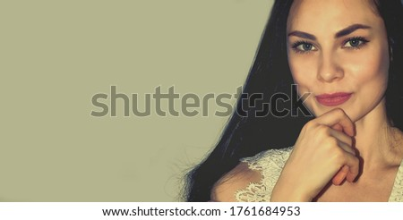 Beautiful woman with nice eyes and long black hair. Attractive model. Old photo. Matte background. Copy space for your text