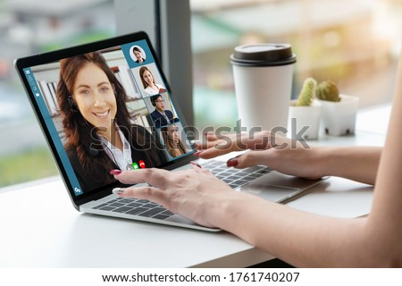 Video call business people meeting on virtual workplace or remote office. Telework conference call using smart video technology to communicate colleague in professional corporate business. Royalty-Free Stock Photo #1761740207