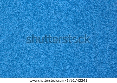 Background Blue Woolen Fabric. Blue flannel fabric texture background simple surface used backdrop or products design. Blue cloth background with fabric texture. Fabric flannel.Place for text. #1761742241