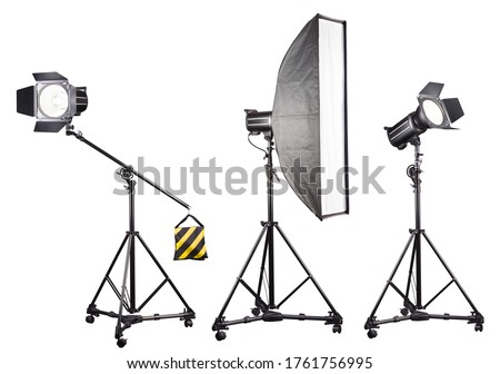 Studio lighting stands with flash and softbox isolated on the white background. Elements of professional photography equipment. #1761756995