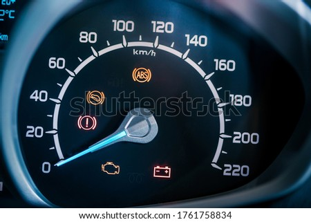 Many different car dashboard lights with warning lamps illuminated. Royalty-Free Stock Photo #1761758834