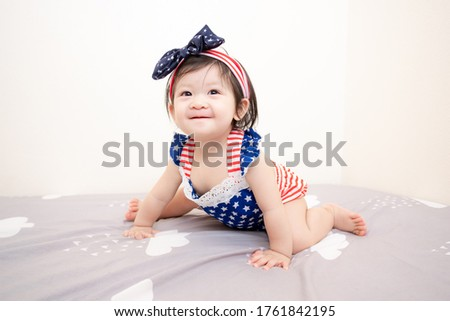 Asian Thai Cute Baby Girl in American Flag Costume, Independence Day.