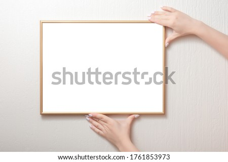 hanging a photo frame mockup on a white wall. Picture frame mockup