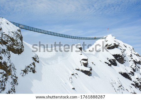 Picture of famous suspension bridge(peak walk) between two moutain peaks, tourist attraction, Glacier 3000, Switzerland: 7/5/2019