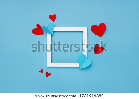 Square white empty frame with hearts on gray textured background with copy space Photo #1761919889