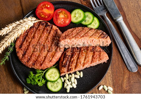 Source of fibre plant based vegan soya protein grilled burgers, meat free healthy food close up Royalty-Free Stock Photo #1761943703