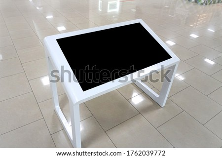 Interactive digital signage, informational kiosk with blank screen isolated. Mockup to showcase products, events, advertising.