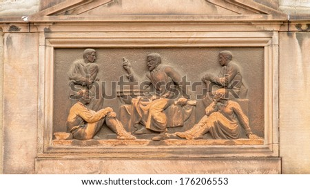 Art Deco inspired classical relief of a teacher or story teller sitting next to a globe surrounded with pupils #176206553