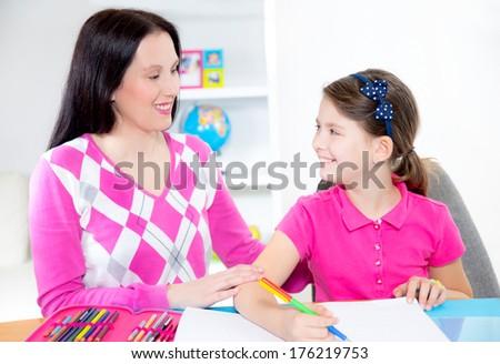 Mother helps daughter of homework #176219753