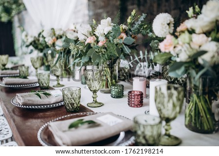Flower decoration of wedding tables. Banquet table setting and decoration. Cutlery on the table.  Royalty-Free Stock Photo #1762198214
