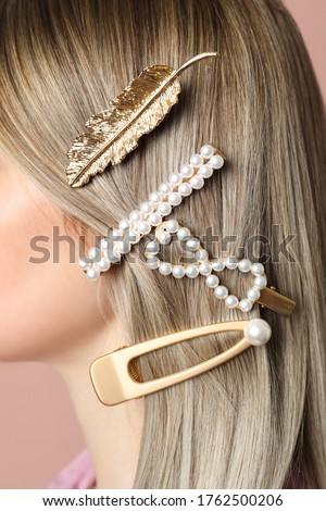 Woman with beautiful different hair clips, closeup Royalty-Free Stock Photo #1762500206