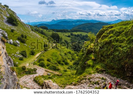 Climbing path to the cave of San Adrian. Mount Aizkorri 1523 meters, the highest in Guipuzcoa. Basque Country. Ascent through San Adrian and return through the Oltza fields #1762504352