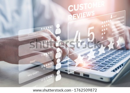 Customer review satisfaction feedback survey concept. User give rating to service experience on online application. Customer can evaluate quality of service leading to reputation ranking of business. #1762509872