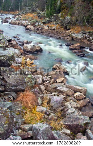 Water autumn landscape. A shallow fast mountain river with a rocky bottom. Ural. #1762608269