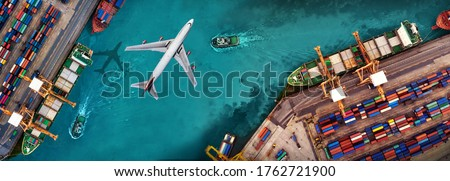 Aerial view and top view cargo plane flying above ship port in the export and import business and logistics international goods. Shipping cargo to harbor by crane #1762721900