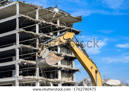 Building House destruction Demolition site Excavator with hydraulic crusher machine ruin house Royalty-Free Stock Photo #1762780475