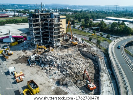 Aerial view of Building House Demolition and construction site Excavator with hydraulic crasher machine Royalty-Free Stock Photo #1762780478