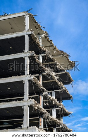 Building House Demolition site Excavator with hydraulic crasher machine and yellow container Royalty-Free Stock Photo #1762780484