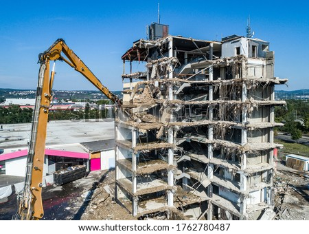 Aerial view of Building House Demolition and construction site Excavator with hydraulic crasher machine Royalty-Free Stock Photo #1762780487