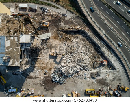 Aerial view of Building House Demolition and construction site Excavator with hydraulic crasher machine Royalty-Free Stock Photo #1762780493