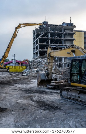 Dawn time Building House Demolition site Excavator with hydraulic crasher machine and yellow container Royalty-Free Stock Photo #1762780577