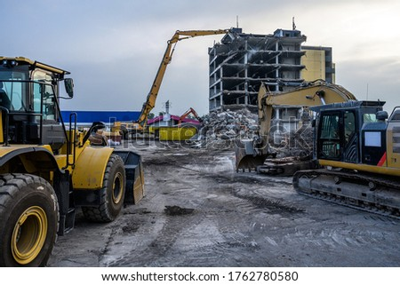 Dawn time Building House Demolition site Excavator with hydraulic crasher machine and yellow container Royalty-Free Stock Photo #1762780580