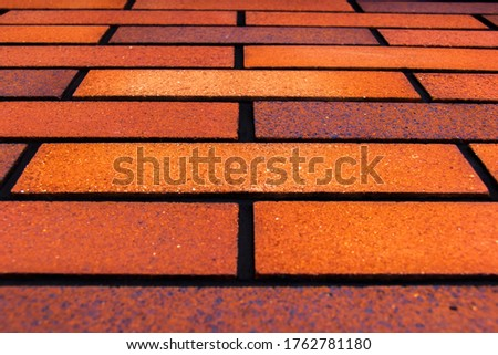 View from a low angle of bricks side by side - on a wall. The front of the brick wall photo #1762781180
